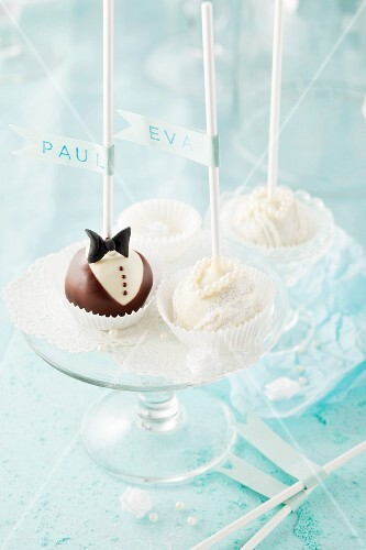 Wedding cupcakes decorated to represent the bride and groom