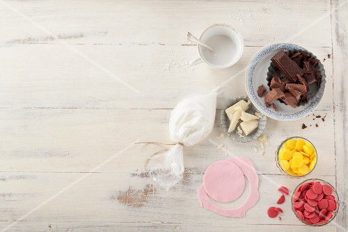 Various ingredients for glazing and decorating cake pops