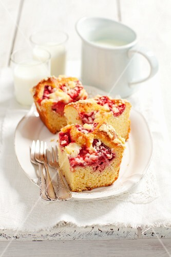 Three slices of yeast dough cake with strawberries