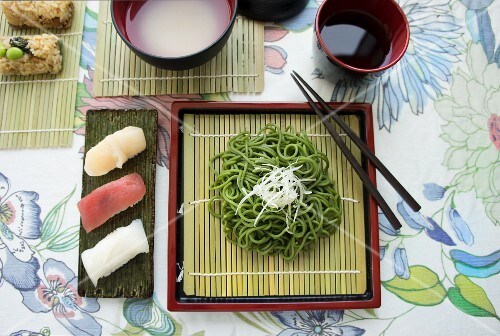 Various types of sushi with wasabi noodles