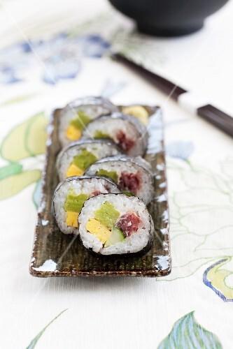 Maki sushi with omelette, cucumber and tuna