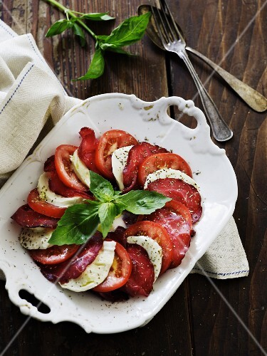 Bresaola (beef ham) with tomato, mozzarella and basil