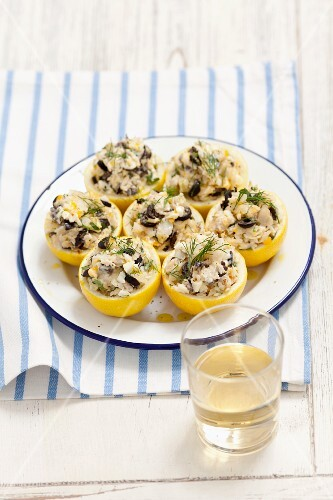 Lemons filled with cod and olives
