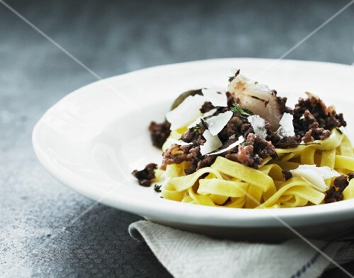 Tagliatelle with a minced game sauce and Parmesan cheese