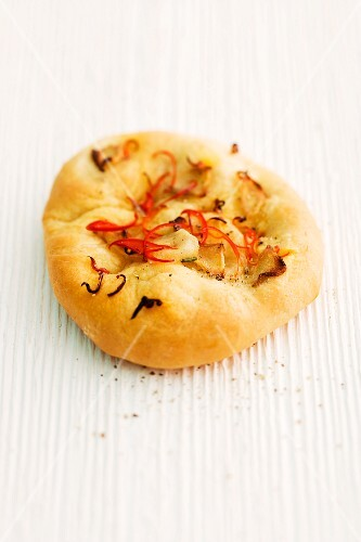 Focaccia with ginger and chilli on a wooden surface