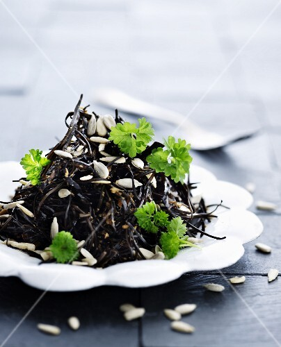 Seaweed salad with parsley and sunflower seeds