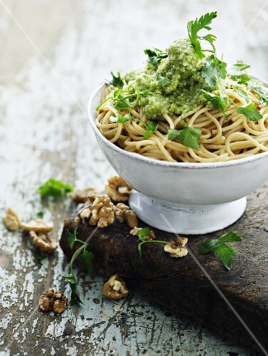 Spaghetti with a herb and walnut pesto