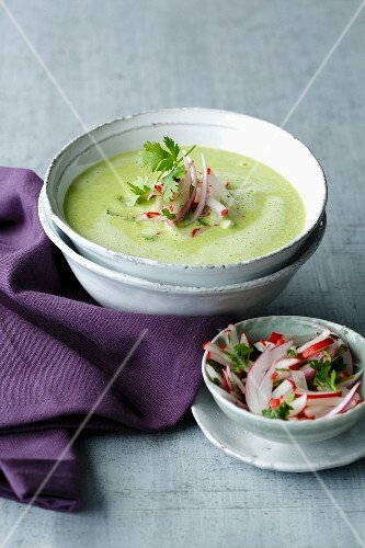 Cream of pea soup with wasabi and radishes