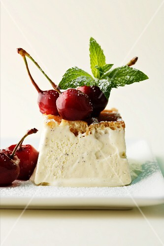 Vanilla ice cream tartlet with cherries and mint