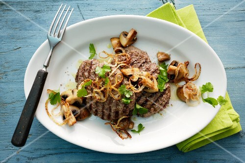 Minced meat steaks with onions and mushrooms