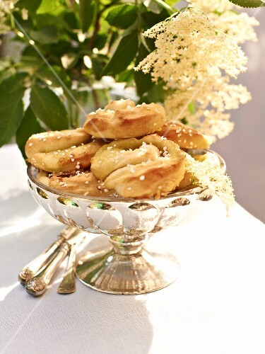 Elderflower pastries in a silver bowl