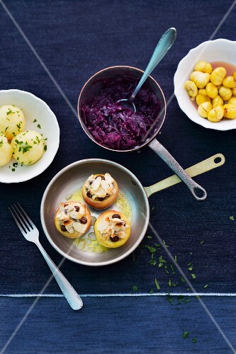 Various side dishes: potato dumplings, red cabbage, chestnuts, baked apples