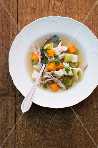 Chicken soup with carrots, celery and leek