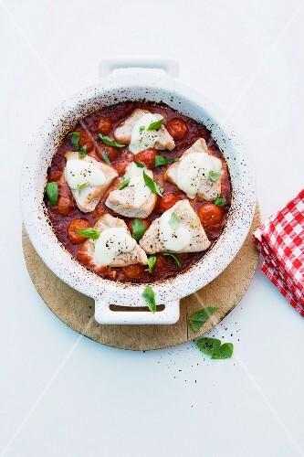 Turkey with tomatoes, mozzarella and basil