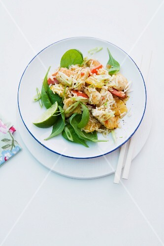 Rice salad with turkey, pineapple, spinach and spring onions