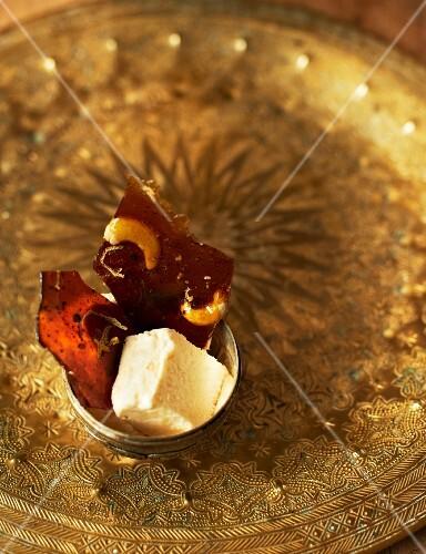 Honey parfait and cashew-orange brittle on a golden plate