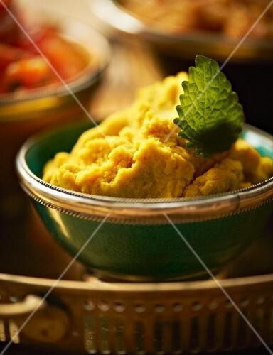 Hummus (oriental chickpea cream) on an appetiser buffet