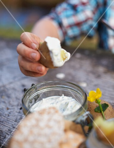 Herb quark, potatoes and crispbread at a spring picnic