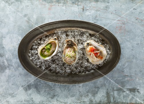 Oysters on ice in metal dish