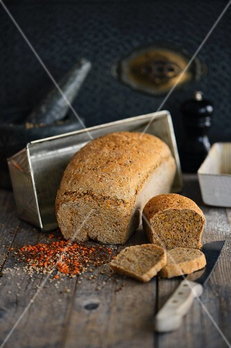 A loaf of bread with red lentils, sesame seeds and flax seeds