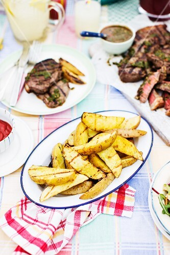 Grilled potatoes and grilled beef steaks