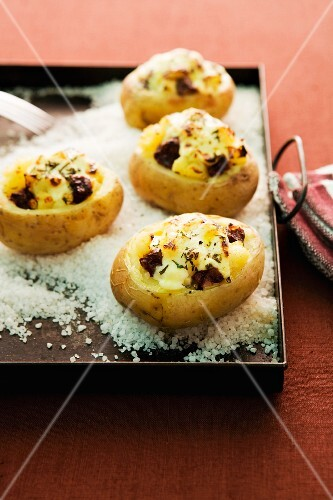 Jacket potatoes filled with Himmel & Erde (black pudding, fried onions, and mashed potato with apple sauce)