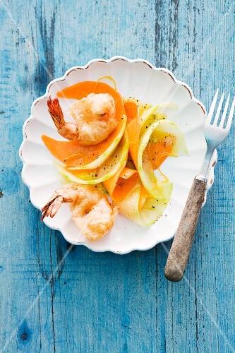 Pumpkin and melon carpaccio with tempura prawns