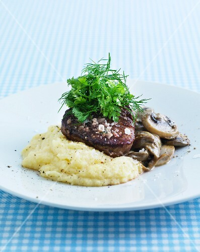Beef fillet with mushrooms, herbs and mashed potatoes