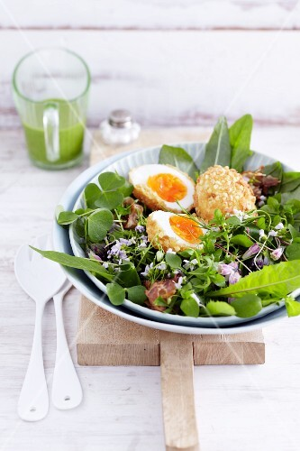 Almond eggs on a wild herb salad
