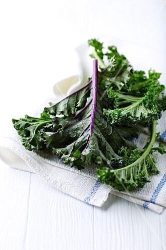 Fresh organic kale on a tea towel