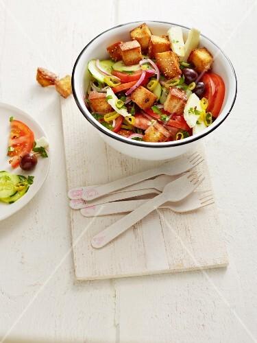 Greek salad with diced unleavened bread