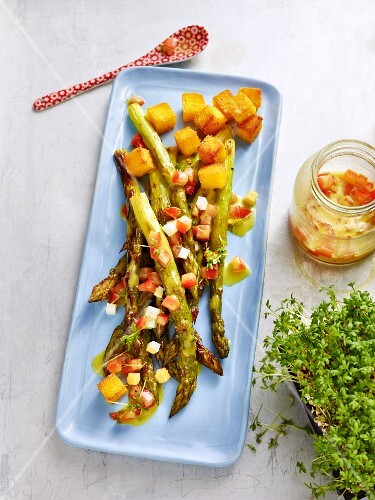 Oven-roasted asparagus with a tomato and egg vinaigrette