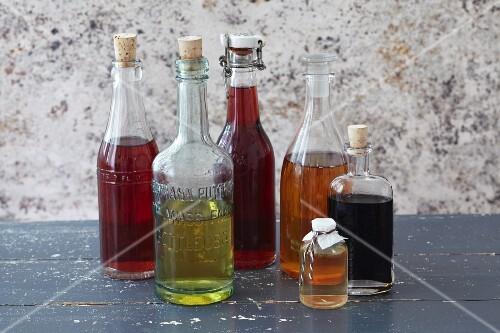 An arrangement of various different types of vinegar in bottles