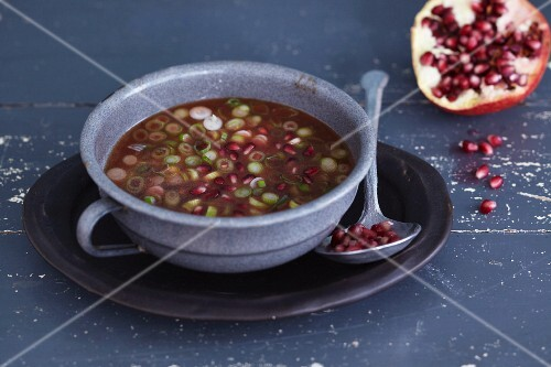 A pomegranate dressing with spring onions