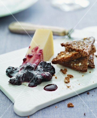Hard cheese with berry jam and wholemeal toast