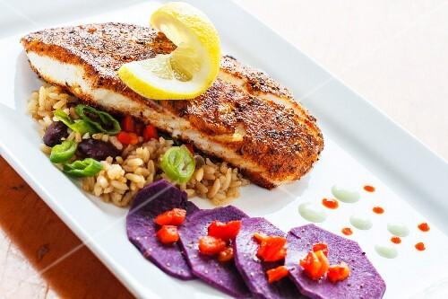 Fried sea bass with rice and purple potatoes