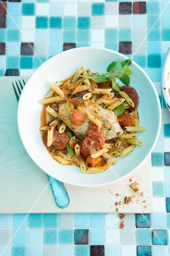 Pasta with sausage and chicken breast