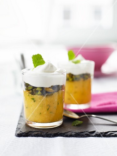 Mango purée with roasted pistachios and vanilla cream