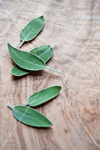 Fresh sage leaves on a wooden board