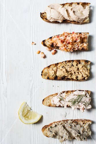 A selection of fish spreads on toasted brown bread