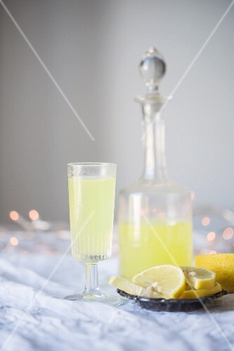 Lemon cocktail in a glass and a carafe