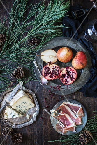Blue cheese, cured meat and a fruit plater (pears and pomegranates)