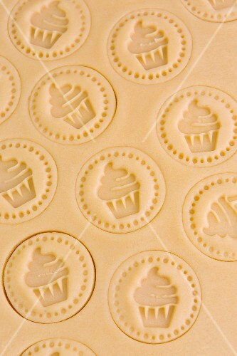 Shortcrust pastry stamped with cupcake motifs