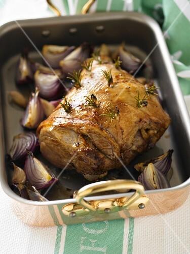 Roast lamb with rosemary, garlic and onions