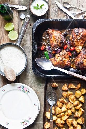 Tandoori chicken legs with basmati rice, potatoes and raita