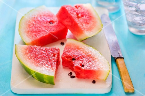 Watermelon chunks on a chopping board
