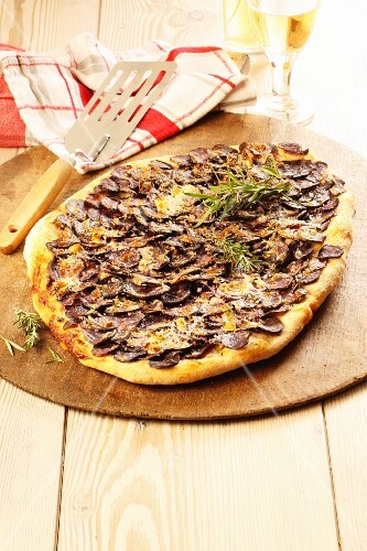 A sausage and rosemary pizza