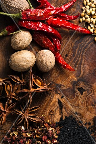 Assorted spices on wooden board