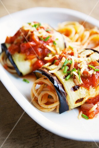 Grilled aubergine rolls with tomato sauce and spaghetti