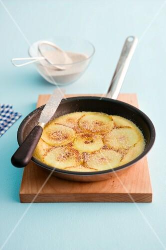 Apple pancakes in a non-stick pan